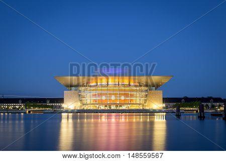 Copenhagen, Denmark - June 05, 2016: The illuminated Opera House designed by Henning Larsen architects by night