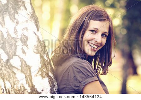 emotional portrait of a cheerful girl. Outdoor portrait