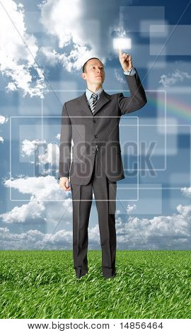 Full Length Businessman Push The Button Outdoors