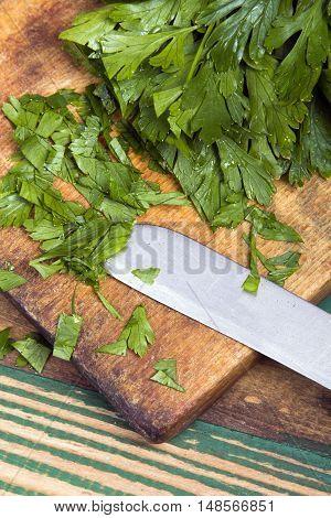 fresh chopped parsley on a chopping board