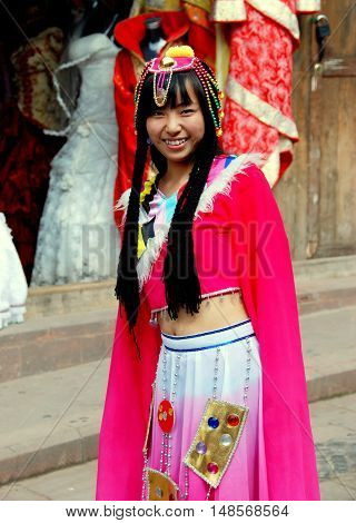 Luo Dai China - October 13 2007: Young woman wearing a rented Hakka people ceremonial dress and headdress