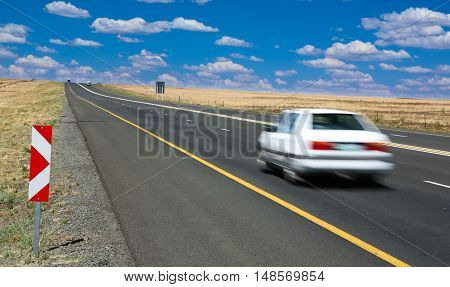 Motor Vehicle or Car travelling along the highway at speed