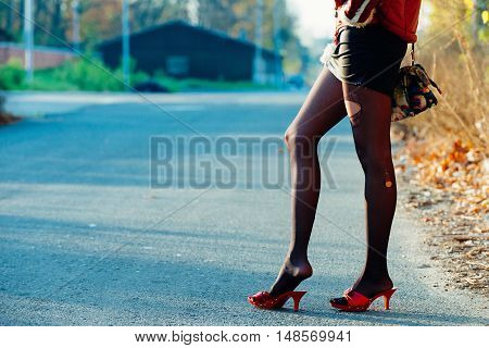 Roadside prostitute waiting for customers. horizontal image, toned image,