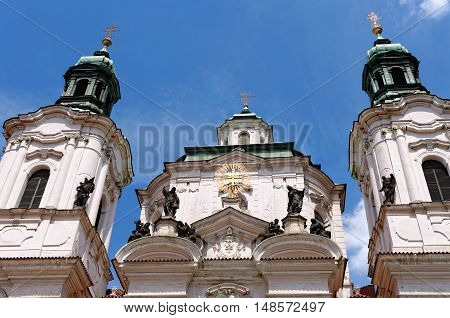The towers of the St. Nicholas Church in the Old Town Square. It is a baroque church which abounds in best known acoustics in Prague thus becomes a place for classical concerts.