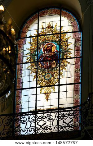PRAGUE, CZECH REPUBLIC - JULY 3, 2014: The interior of the church of St. Nicholas in Old Town Square. The stained glass picture of St.Wenceslav - the patron of the Czech country.