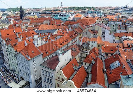 Aerial view: Houses with traditional red roofs in Prague. Prague (Praha) is capital and largest city of Czech Republic and historical capital of Bohemia.