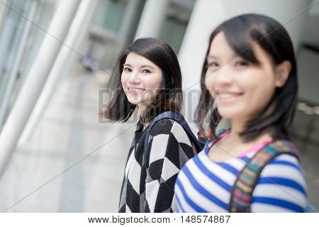 two beauty woman smile happy to you in hong kong airport asian