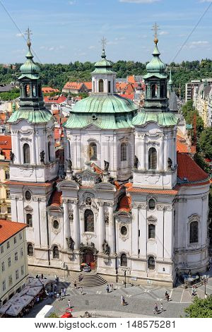 PRAGUE CZECH REPUBLIC - JULY 3 2014: St. Nicholas Church in the Old Town Square. It is a baroque church which abounds in best known acoustics in Prague thus becomes a place for classical concerts.