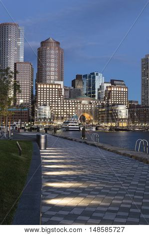 Dawn view of Rowes Wharf in Boston from Harborwalk along Fan Pier in South Boston