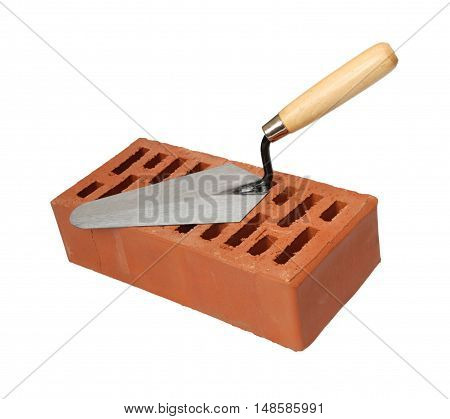 Brick and trowel on a white background.