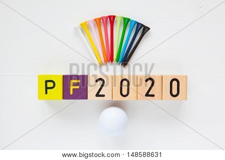 P.F.2020 - an inscription from children's wooden blocks and golf ball and wooden tees - Flat Lay Photography