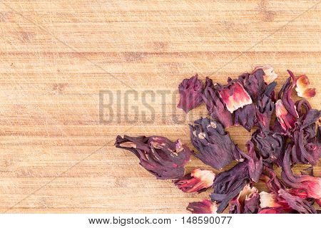 Dried hibiscus sepals from the crimson Hibiscus sabdariffa plant for making an infusion or herbal tea with strong antioxidant properties lowers blood pressure immune system and anti-inflammatory
