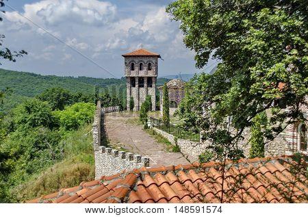Giginski monastery, Bulgaria - June 25, 2016: View of inner  part yard with bell tower in restored Montenegrin or Giginski monastery  St. St. Cosmas and Damian, mountain,  Kitka, Breznik, Pernik region, Bulgaria.  Visit in the place circa June 2016.