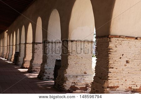 This is an image of archways at an old California Mission taken on a sunny day.