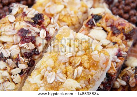 Sweet cereal bar with different berries and fruits. Diet sweets healthy food