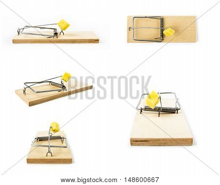 Mousetraps with cheese isolated on white background. Collage with Mousetrap.