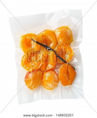 Vacuum sealed fresh apricots with vanilla for sous vide cooking cutout on white