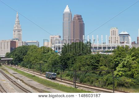 Cleveland Skyline:  A view of a part of downtown Cleveland, Ohio including the city's tallest buildings and the professional baseball stadium, with one of the mass transit trains in the foreground