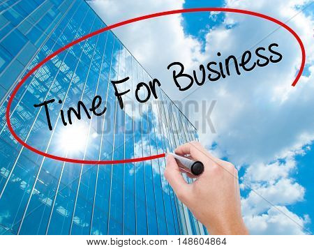 Man Hand Writing  Time For Business  With Black Marker On Visual Screen