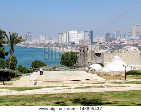 Jaffa Israel - March 22 2012: The Amphitheatre on the background of Skyscrapers of Tel Aviv in old city.