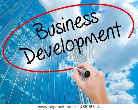 Man Hand Writing Business Development With Black Marker On Visual Screen.