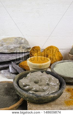 Ancient minerals - ochre green and blue clay powder and mud mask for spa beauty concept