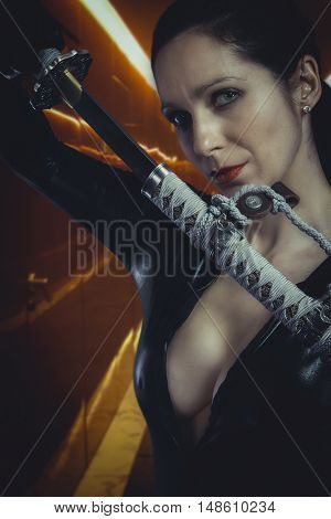 Anime stylized sexy brunette with holding a katana sword with two hands.