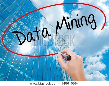 Man Hand Writing  Data Mining With Black Marker On Visual Screen