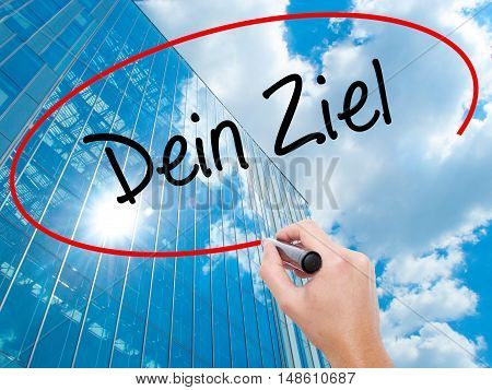 Man Hand Writing Dein Ziel (your Goal In German)  With Black Marker On Visual Screen