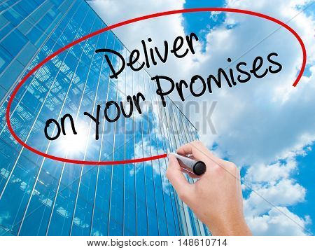 Man Hand Writing Deliver On Your Promises With Black Marker On Visual Screen