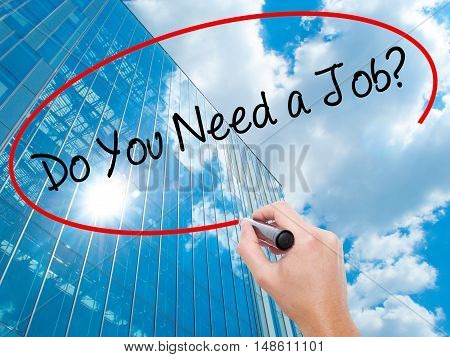Man Hand Writing Do You Need A Job? With Black Marker On Visual Screen