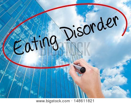 Man Hand Writing Eating Disorder  With Black Marker On Visual Screen