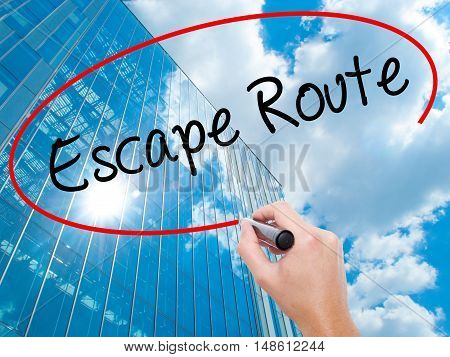 Man Hand Writing Escape Route With Black Marker On Visual Screen
