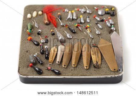 Set of old handmade lures for ice fishing, isolated