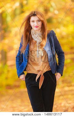Modest Girl In Autumnal Enviroment.