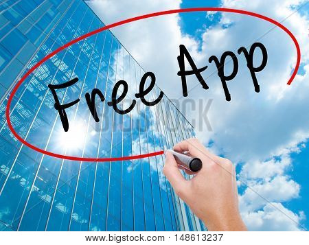 Man Hand Writing Free App With Black Marker On Visual Screen
