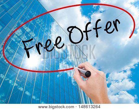 Man Hand Writing Free Offer  With Black Marker On Visual Screen
