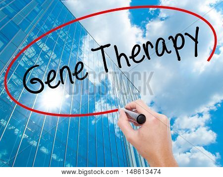 Man Hand Writing  Gene Therapy  With Black Marker On Visual Screen