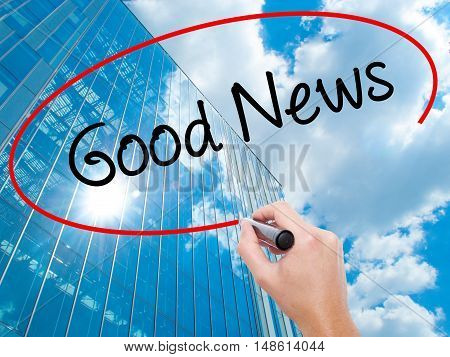 Man Hand Writing Good News With Black Marker On Visual Screen