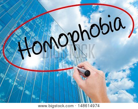 Man Hand Writing Homophobia With Black Marker On Visual Screen