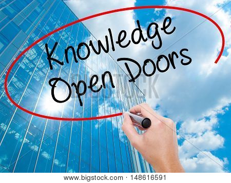 Man Hand Writing  Knowledge Open Doors  With Black Marker On Visual Screen