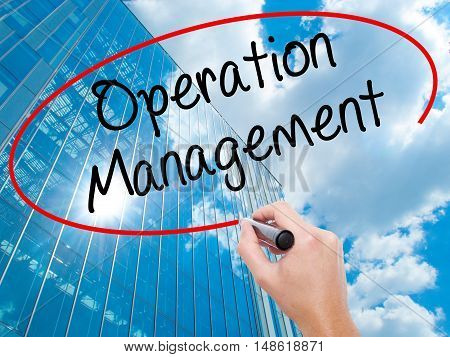 Man Hand Writing Operation Management With Black Marker On Visual Screen.