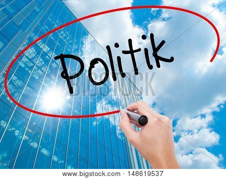Man Hand Writing Politik (politics In German) With Black Marker On Visual Screen