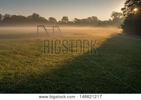 Soccer field on a foggy misty morning