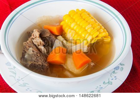 beef soup with fresh onion, carrots and corn