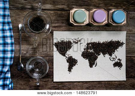 map of the world, lined with tea leaves on old paper. Eurasia, America, Australia, Africa. vintage.