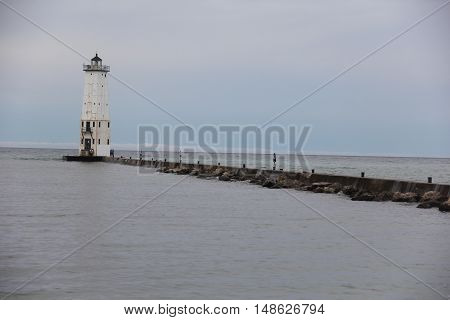 Breakwater and Lighthouse in Frankfort, Michigan in fall