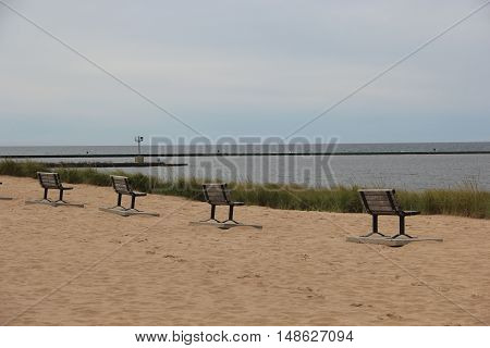 Park benches on the beach Frankfort, Michigan