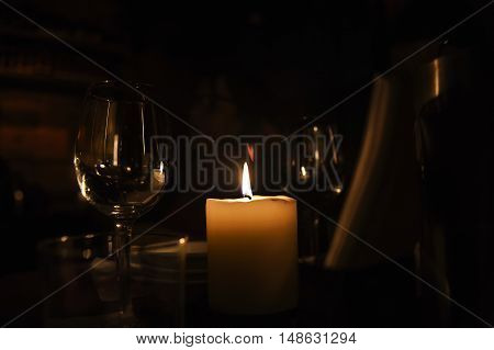 Romantic evening with wineglass and candle on a table