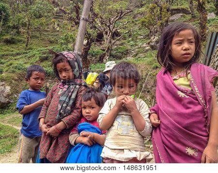 ANNAPURNA NEPAL - APRIL 14 2012 : Children at way to Annapurna base camp Nepal
